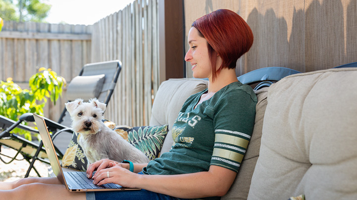 girl with laptop and dog