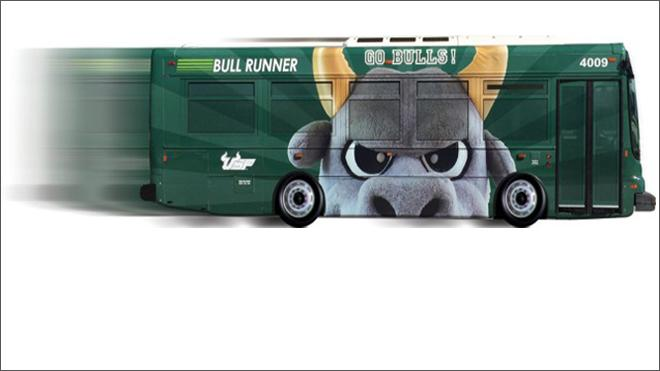 USF bus with a picture of Rocky the bull's face on the side of it.