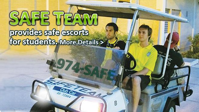 Safe Team provides safe escorts for students 3 men driving in a golf cart.
