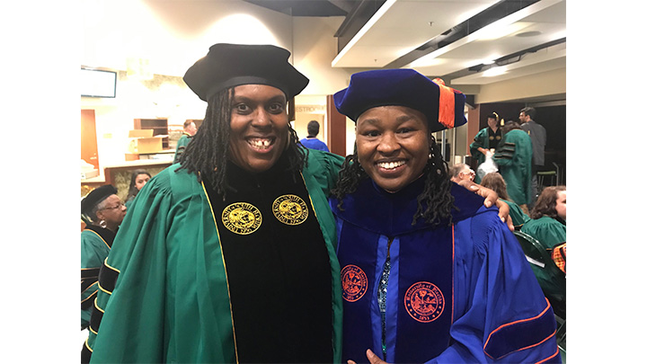 Dr. Robinson and Dr. Jackson wearing their regalia at graduation
