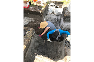 Undergraduate students at Dr. Wallman's 2018 Archaeological Field School excavate a large privy feature uncovered during previous field work