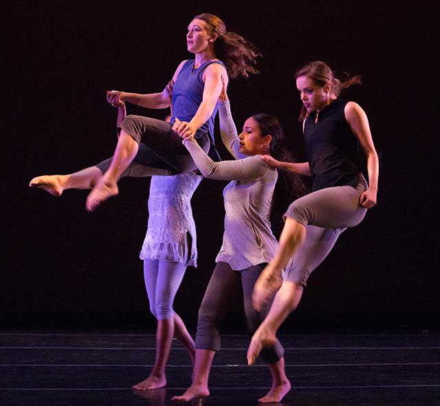 Advanced Dance Studies - Photo of dance students performing a group choreography.