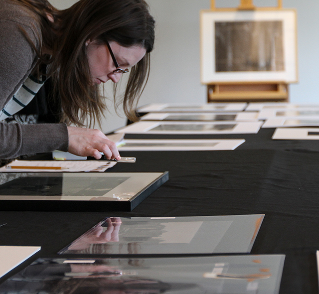 Art History - Photo of art history student examining details of photographs.