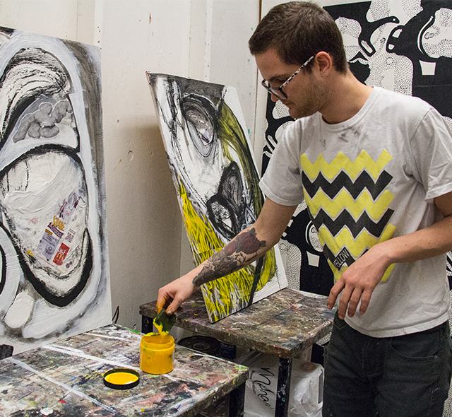 Studio Art - Photo of student expressing creativity while painting in the studio.