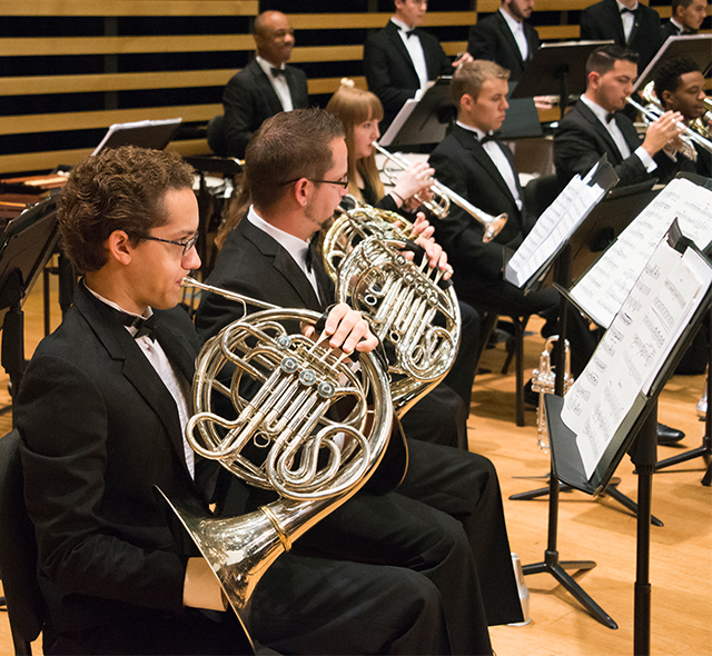 Brass Performance - Photo of music students performing with brass ensemble.