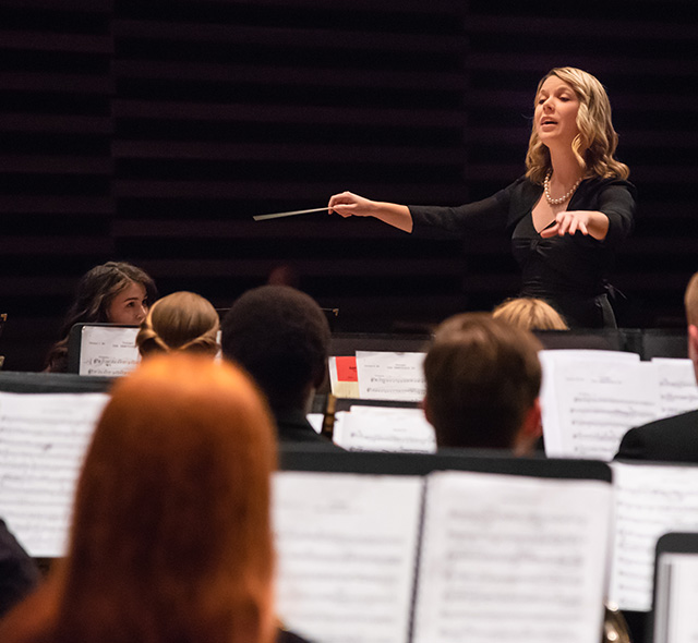 Conducting (Choral or Instrumental) - Photo of singers referencing standing conductor during a performance.
