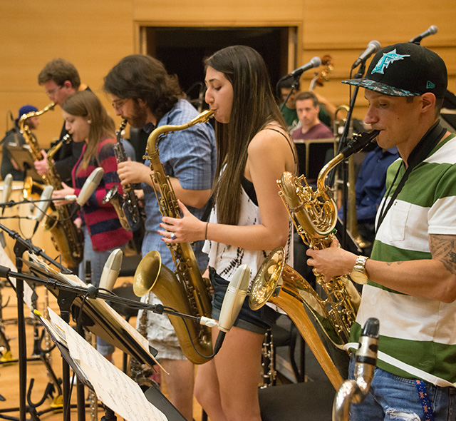 Jazz Studies (Performance) - Photo of jazz students rehearsing their saxophone parts for a performance.
