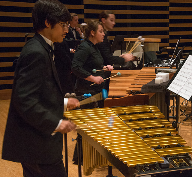 Percussion Performance - Photo of students playing marimbas on stage.