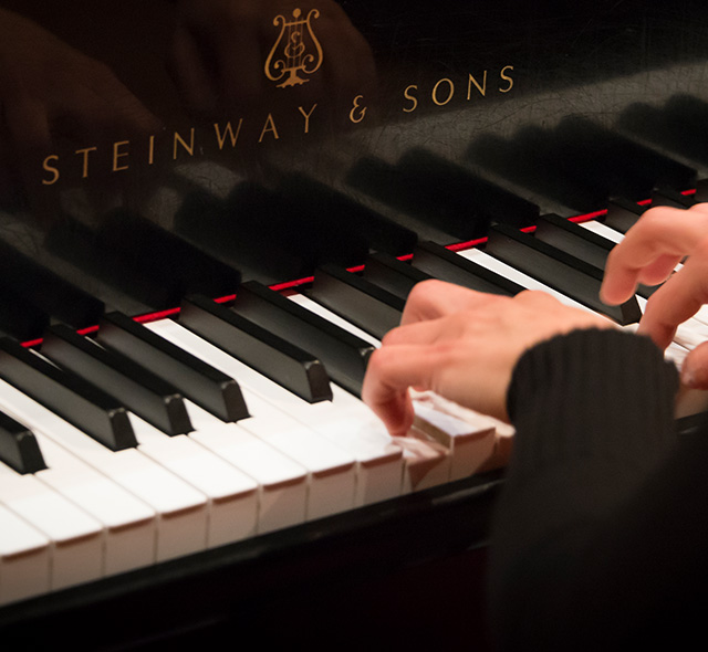 Piano Pedagogy - Photo of piano student practicing a melody on a Steinway and Sons piano.