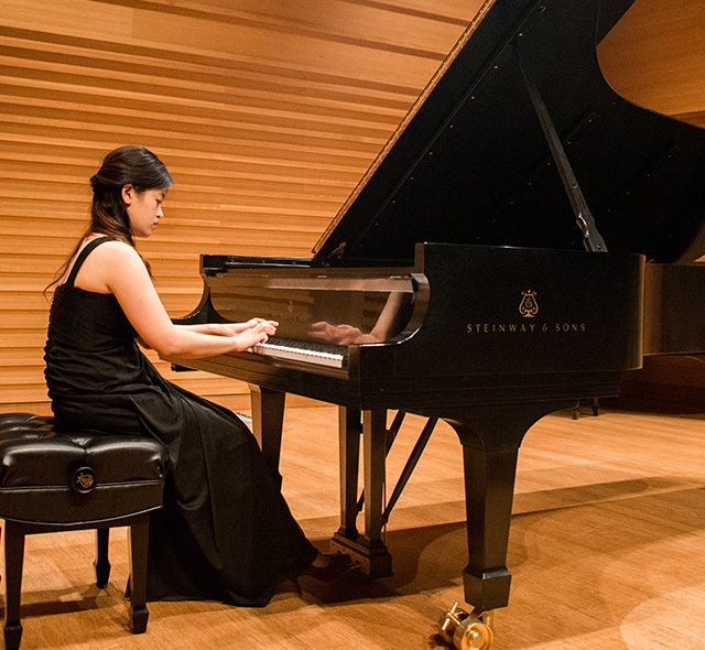 Piano Performance - Photo of music student playing during piano performance.