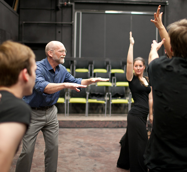 Theatre Arts - Photo of theatre students and professor rehearsing movement and expressions.