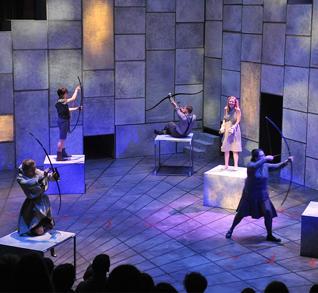 Theatre Design - Photo of a completed set and lighting design during a performance in USF Theatre 2.