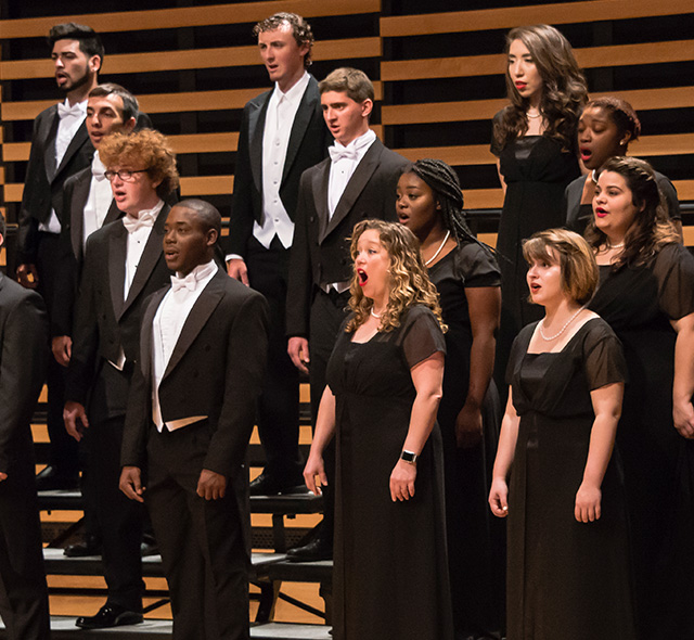 Voice Performance - Photo of choir students performing a song.