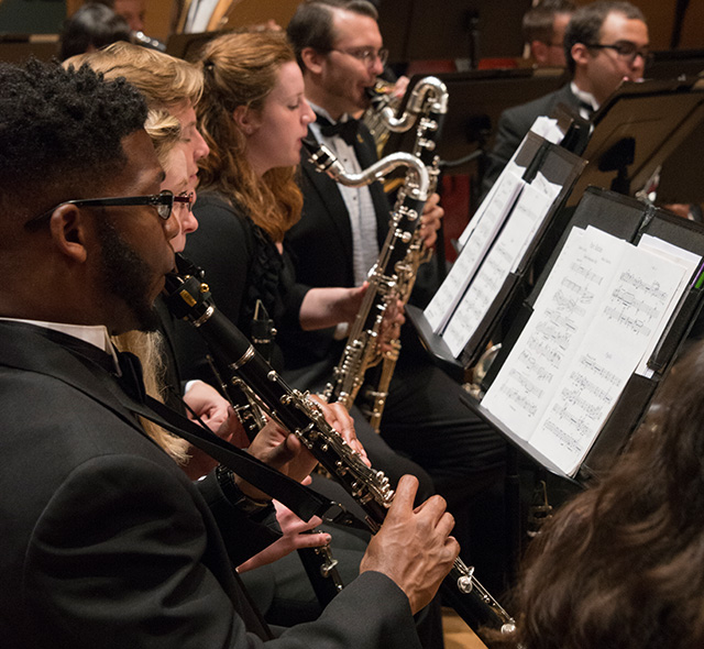 Woodwinds (Performance) - Photo of the woodwind ensemble performing on stage