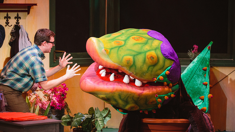 Seymor and Audrey II in USF's musical theatre production of Little Shop of Horrors