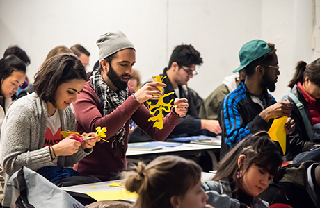 Students participating in the Chinese paper cutting class by visiting artist Xin Song