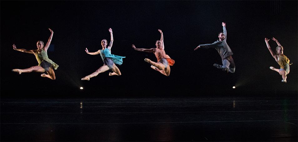 USF Dance students leaping during a performance of the 2018 Spring Dance Concert