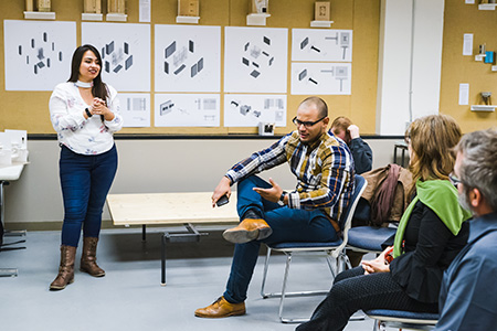 USF Architecture Student presents her master's thesis project during a midterm review panel.