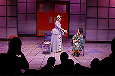 Apply for Admission - Photo of two students performing a play on the USF Theatre 2 stage.
