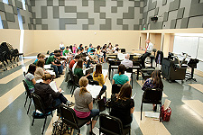 Current Students - Photo of music students practicing in an ensemble rehearsal room at the USF School of Music.