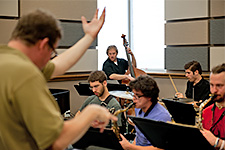 Graduate Orientation - Music students and a professor rehearsing for a concert in the USF Jazz Rehearsal Hall.