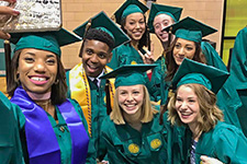 USF Graduation Application - Photo of graduating Theatre & Dance students taking a selfie while waiting for the commencement ceremony to begin