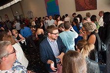 RSVP to Attend The Arts' Graduation Celebration - Photo of guests mingling at the Graduation Celebration reception.