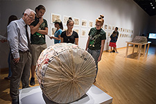 Transfer Orientation - Photo of students and a professor analysing a sculpture in the USF Contemporary Art Museum.