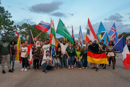 USF intenational students holding flags from different countries.