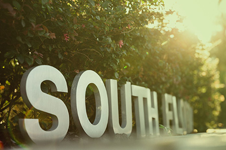 South Florida sign in front of the ALN building on the USF Tampa Campus