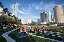 Visit Tampa Bay - Photo of people doing yoga at Curtis Hixon Waterfront Park in downtown Tampa