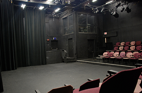 Black box theatre view of seating and performance area.