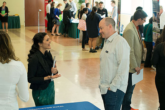 Student and job recruiter having a conversation at the Architecture Career Expo