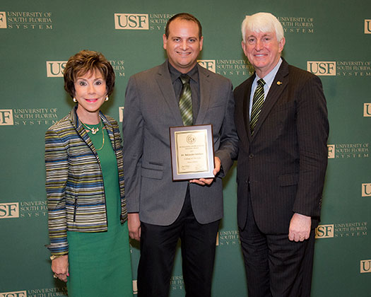 USF President Judy Genshaft, Professor Baljinder Sekhon, and Provost Ralph Wilcox pose for a photo at the 2017-2018 Faculty Honors & Awards Reception