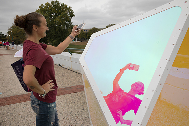 "A woman takes a selfie in front of ""Oscillation"" in Grand Rapids, Michigan"