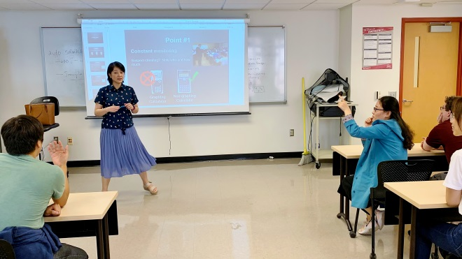 Professor Rong Zhang teaching a class.