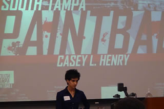 Casey Henry presenting at the competition