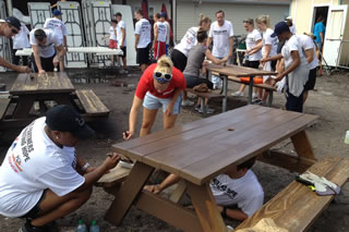 Students painting picnic tables