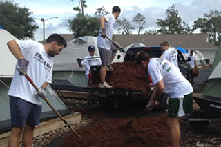 Students spreading mulch