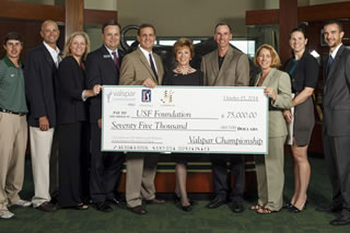 USF President Judy Genshaft, faculty and students from the Muma College of Business, USF athletics officials, and members of the USF golf program gathered at the Lee Roy Selmon Athletics Center on Wednesday to graciously accept a $75,000 gift from Copperhead Charities.