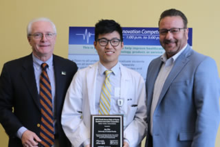 Michael Fountain and David Pizzo with competition winner Jae Kim