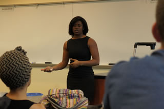 Ashley Washington speaks to a class full of Corporate Mentor students.