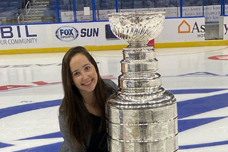 Amy Rubin posting with Stanley Cup