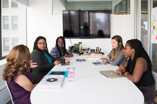 Women sitting in conference room