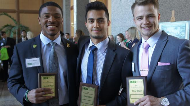 Photo of Syed Ahmed, Marcus Wingate, and Mosheh Vann in suits holding awards.