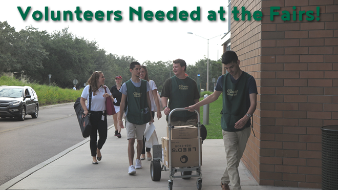 "Picture of volunteers helping an employer bring materials to their booth at a career fair with the text ""volunteers needed at the fairs"" overlaid."