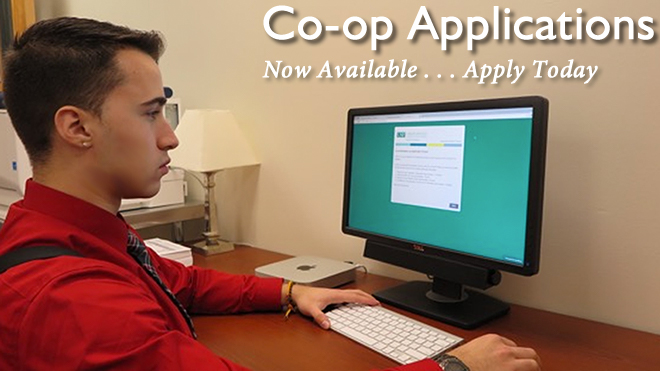 Student at a computer. Co-op Applications now available. Apply today.