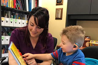 boy patient with hearing aids and SLP