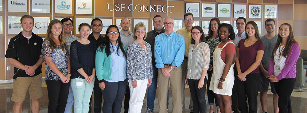 Picture of a team of USF researchers with their professors.