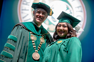 President Steven Currall with student at commencement